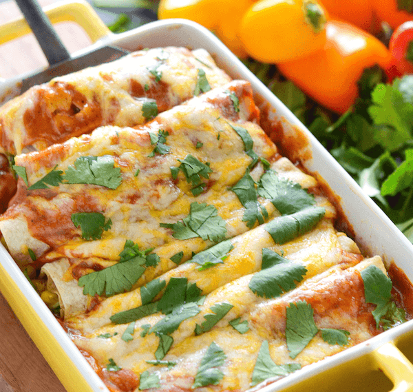These cheesy Vegetable Enchiladas are truly the best, with their flavorful homemade sauce made in just 5 minutes, and loaded vegetable and cheese filling! #enchiladas #recipe #vegetables #vegetarian