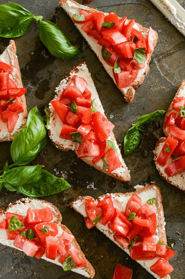 Pieces of Tomato Goat Cheese Toast on a Baking Sheet