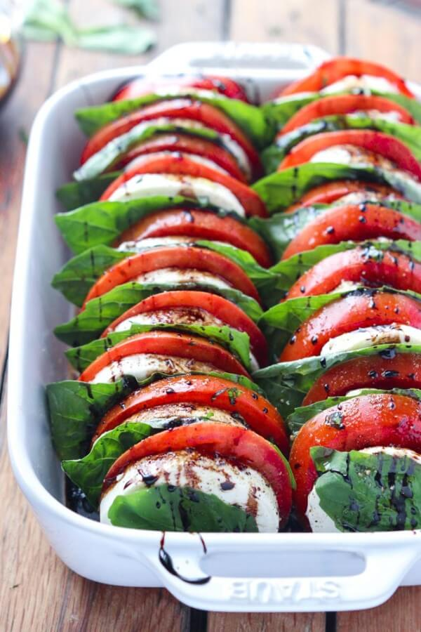 A Pan Full of Tomato Mozzarella Salad with Balsamic Reduction