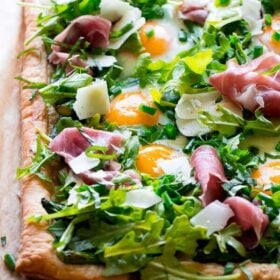 Close up of Asparagus Egg Prosciutto Tart with Summer Salad