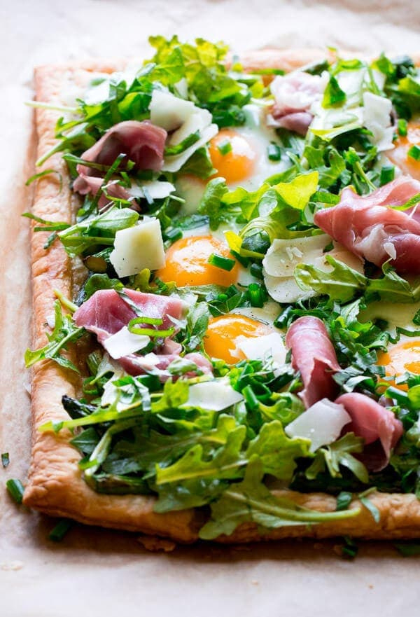 An Asparagus Egg Prosciutto Tart Topped with a Summer Salad