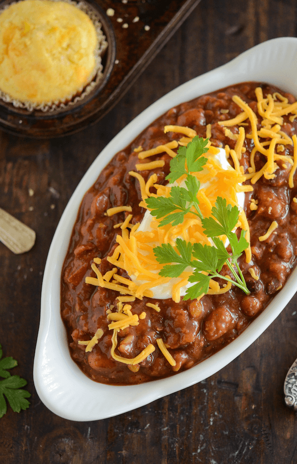 A Dish Filled with Bean Chili Next to a Cornbread Muffin