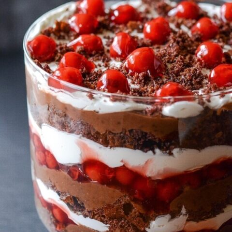 Close-up of Black Forest Trifle topped with cherries and black forest crumbles