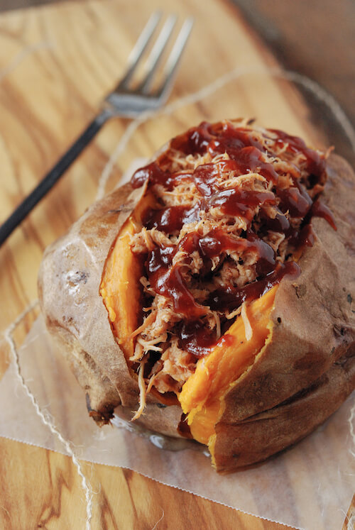 A Pulled Pork Stuffed Sweet Potato with a Fork