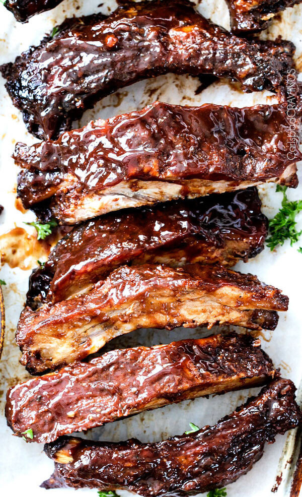 Slow Cooker Barbecue Ribs Lined up on a Cutting Board