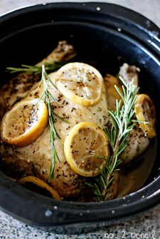 Lemon Garlic Chicken in a Black Bowl with Lemon Slices