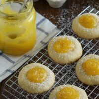 A Batch of Round Shortbread Cookies Filled with Lemon Curd and Garnished with Powdered Sugar