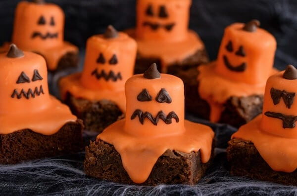 Seven Halloween Jack O' Lantern Brownies with Different Expressions on their Faces