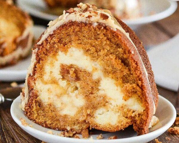 Sweet Potato Cream Cheese Bundt Cake: this rich, moist, sweet potato spiced cake is swirled with sweet cream cheese and topped with a pecan praline frosting. #Cake #BundtCake #SweetPotato #FallRecipes