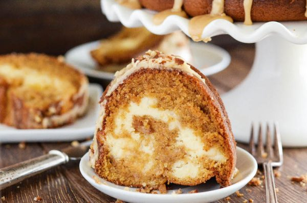 Sweet Potato Cream Cheese Bundt Cake: this rich, moist, sweet potato spiced cake is swirled with sweet cream cheese and topped with a pecan praline frosting. #Cake #BundtCake #SweetPotato #FallRecipes