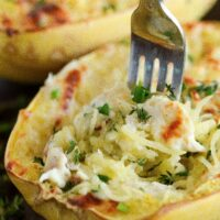 Close up of Four Cheese Chicken Stuffed Spaghetti Squash with a fork