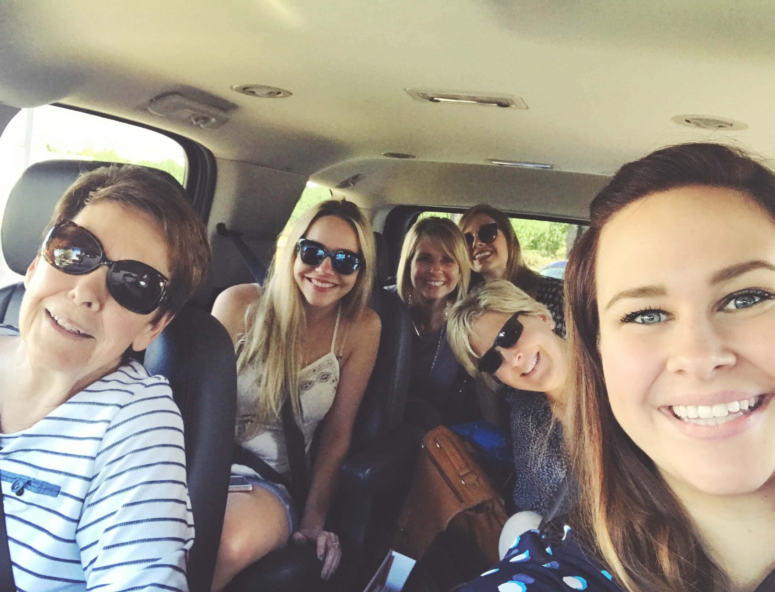A Car Full of Six Women Driving to Magnolia Market