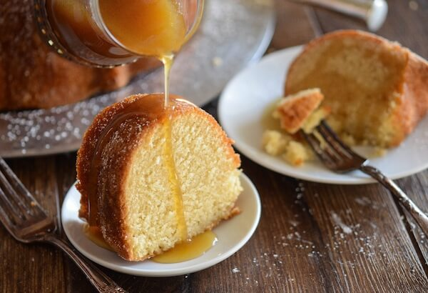 Almond Amaretto Pound Cake - A dense, moist poundcake flavored with almond and amaretto liquor topped with a warm buttery amaretto sauce. #Cake #Dessert #BundtCake #Almond