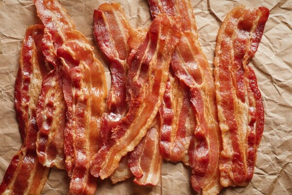 Crispy fried bacon on parchment paper