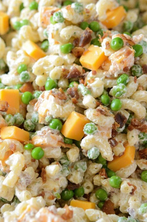 Up close image of bacon ranch pasta salad with cheese.