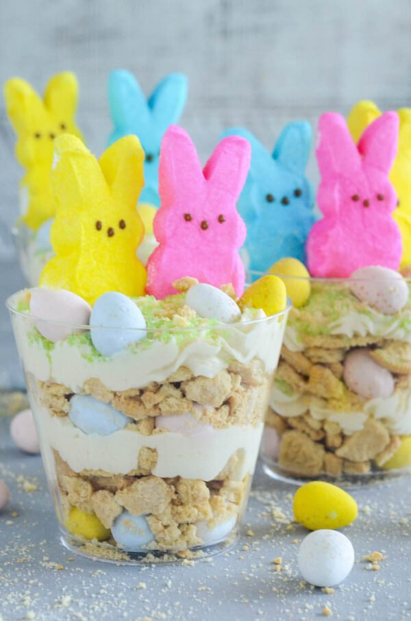 Oreo Easter Egg Cups are the perfect no bake Easter dessert with layers of crushed vanilla oreos, oreo cream filling buttercream, mini cadbury eggs and peeps!
