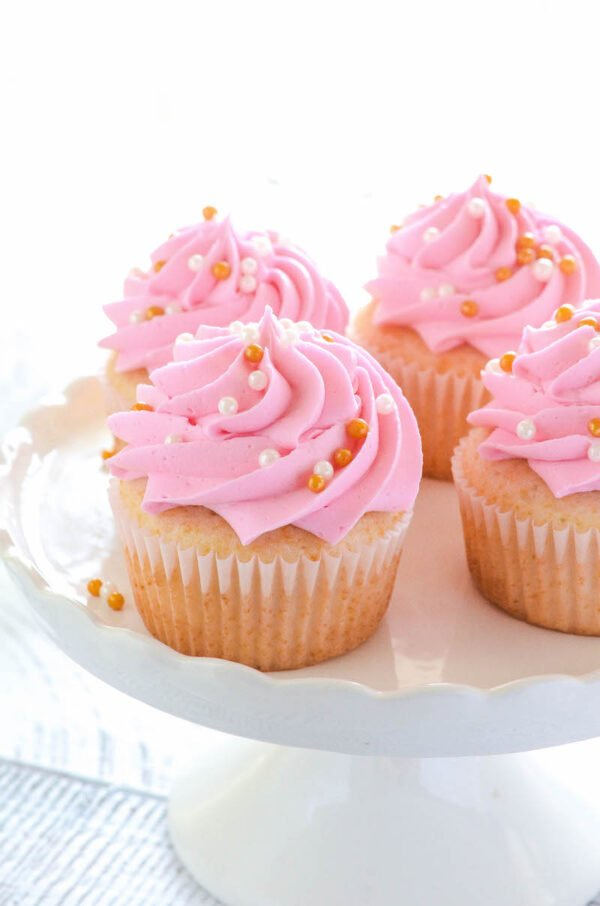 Pink Champagne Cupcakes are perfect for Mother's Day or a bridal shower, with almost two cups of sparkling rosé, you can taste the champagne in every bite!