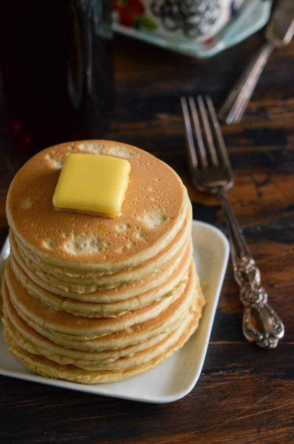 Keto Pancakes in a freshly cooked stack with a slice of butter on top.
