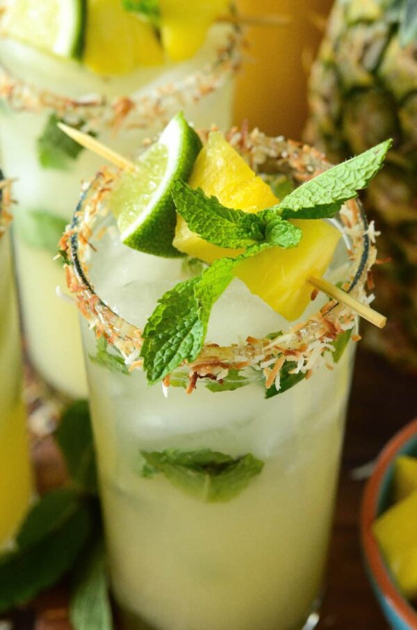 Pineapple Coconut Mojito: the classic mint mojito is remixed with another tropical favorite, the piña colada, to create the ultimate fresh summer rum cocktail! #PineappleCoconutMojito #Mojito #Cocktail #Coconut #Pineapple