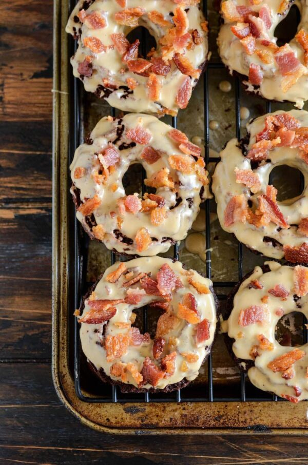 Chocolate Maple Bacon Donuts: old fashioned chocolate donuts, made extra tender with hidden yogurt, are fried and dunked in a maple glaze and topped with bacon!