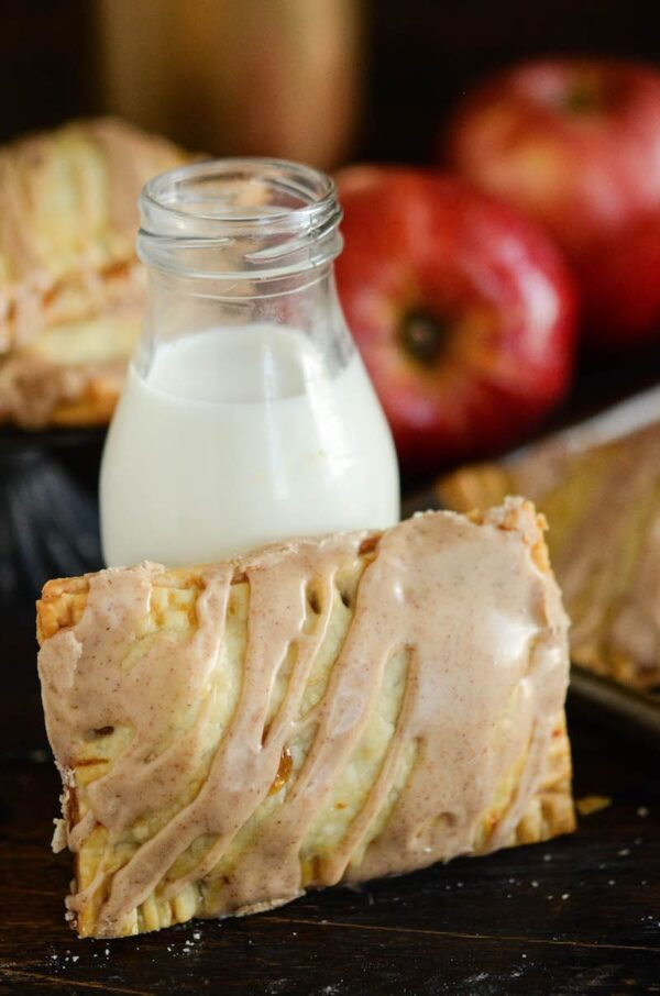 Apple Pie Poptarts: warm flaky poptarts are filled with a homemade brown sugar apple filling, baked till golden and topped with a sweet cinnamon frosting.