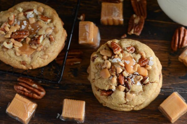 Salted Caramel Crunch Cookies: a one-bowl chewy brown sugar cookie with toffee bits, chopped pecans, caramel bites and sprinkled with flaked sea salt!