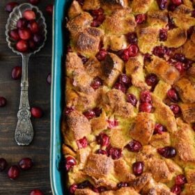 Cranberry Eggnog Bread Pudding: kick off the holidays with this rich bread pudding with cranberries, eggnog, cinnamon and a generous pour of buttery rum sauce!