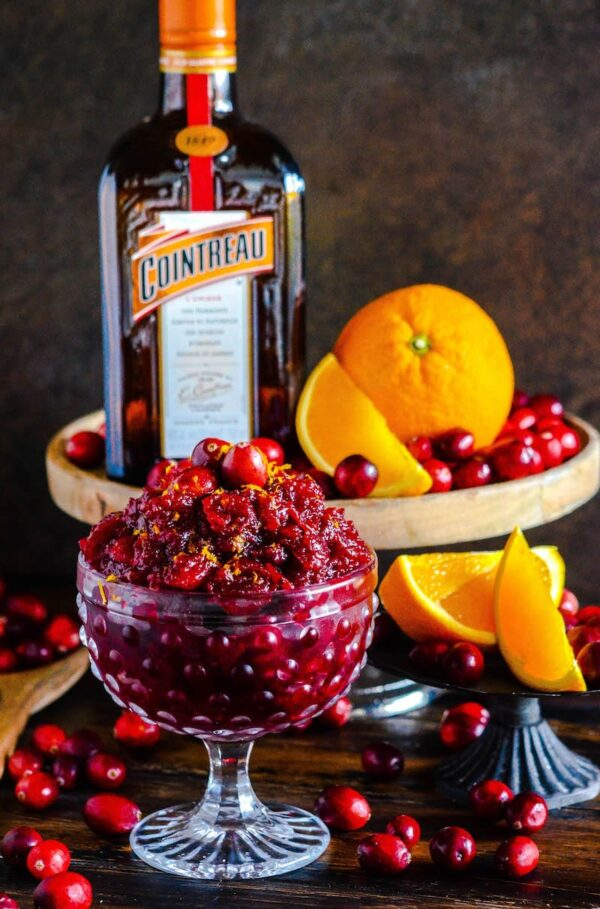 Cranberry Orange Relish in a crystal bowl with oranges, cranberries and cointreau.