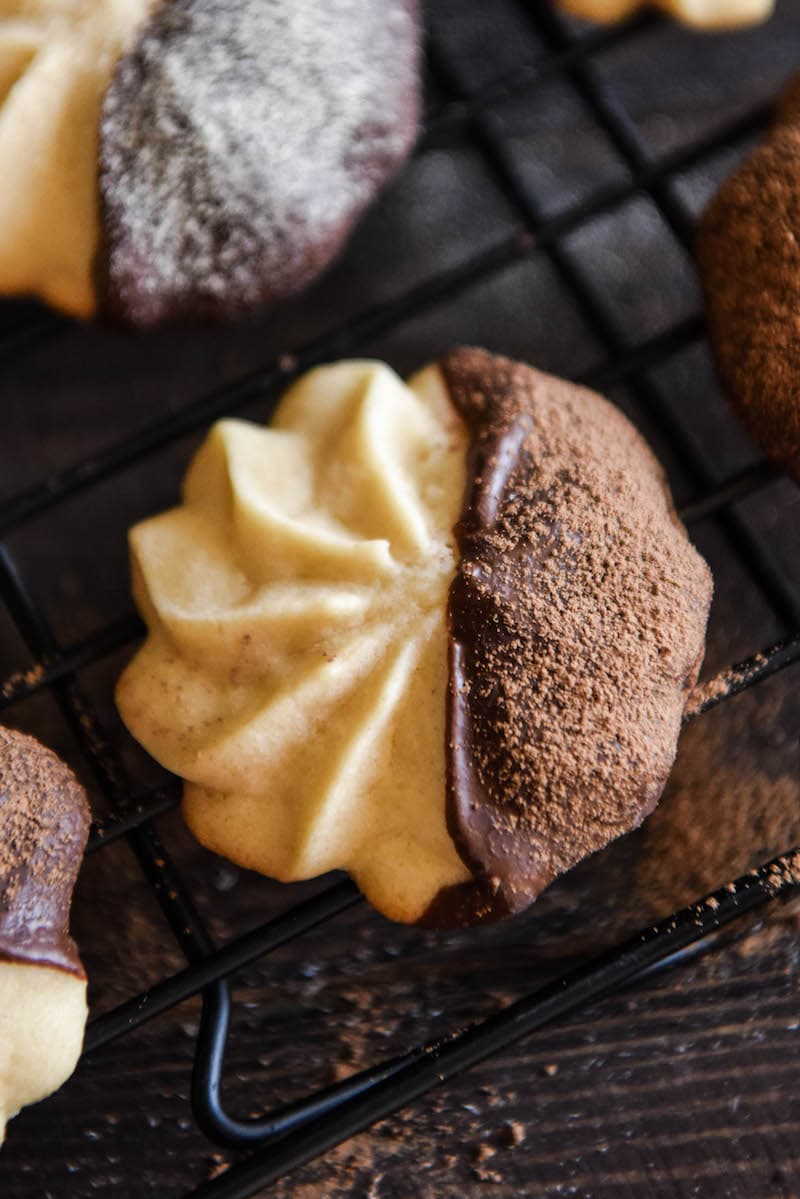 A Malted Shortbread Cookie Dipped in Dark Chocolate and Dusted with Cocoa Powder