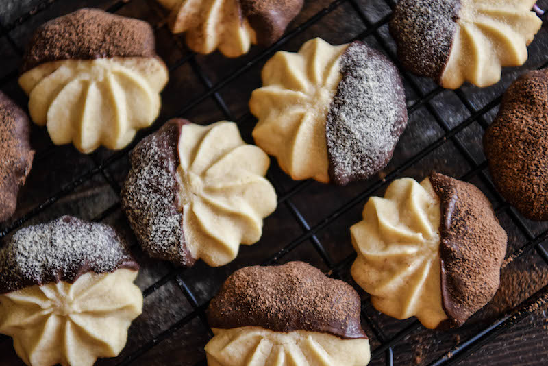 Ten Malted Shortbread Cookies with Half of Each Cookie Covered in Chocolate
