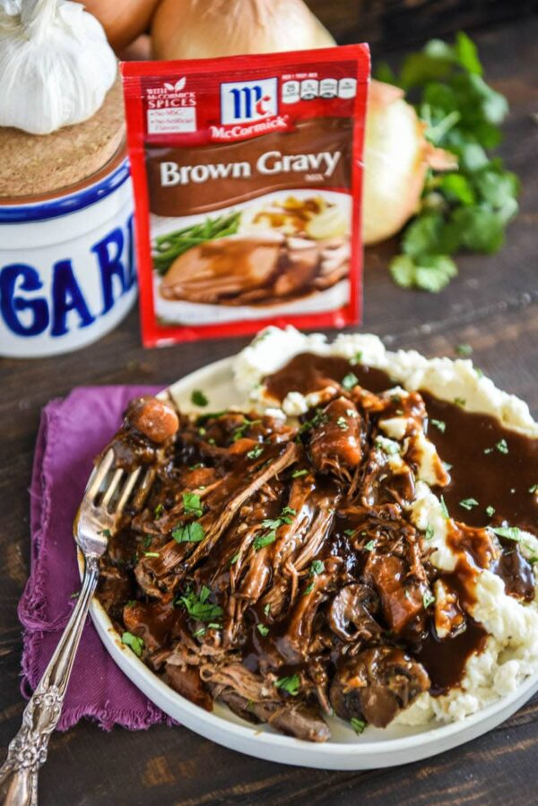 Instant Pot Beef Pot Roast: a favorite family recipe for an extra flavorful beef pot roast that can be made in a crock pot or instant pot! You will never guess the secret ingredients!