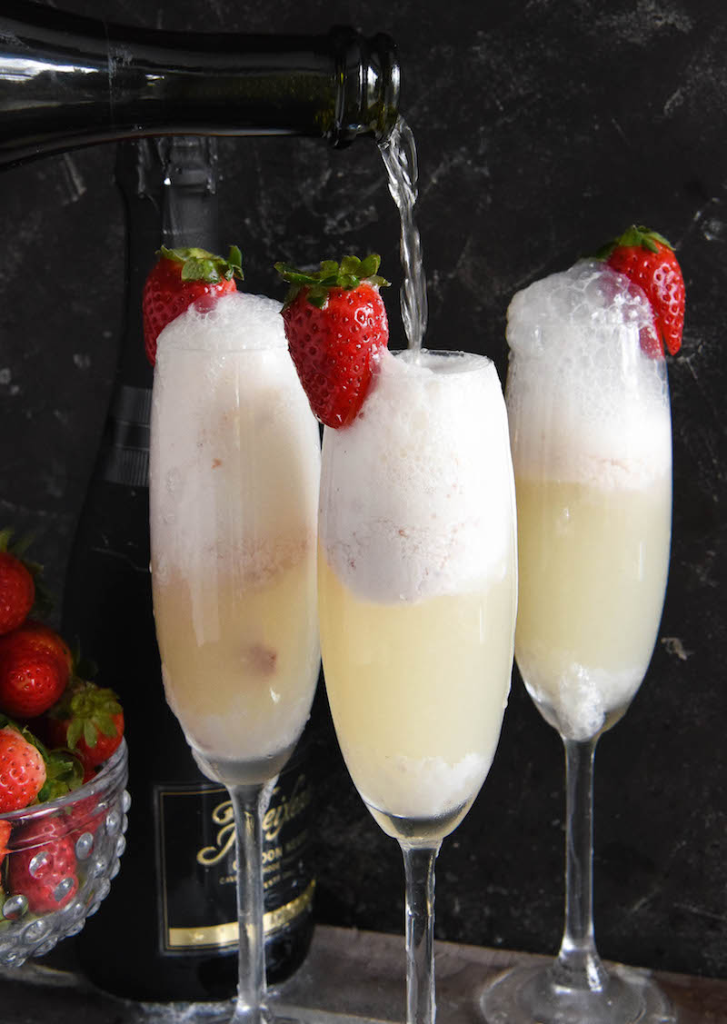 Strawberry Champagne Floats: these spiked floats are the perfect way to toast the New Year with their fruity flavor from homemade no-churn strawberry ice cream!