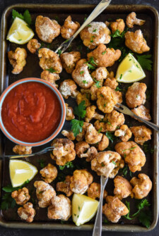Old Bay Crispy Cauliflower Cocktail: a vegetarian twist on the classic shrimp cocktail featuring sheet pan crispy baked cauliflower!
