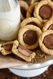 Peanut Butter Cookie Cups: soft homemade peanut butter cookie cups are baked in a mini muffin tin and then stuffed with chocolate Reese's peanut butter cups!
