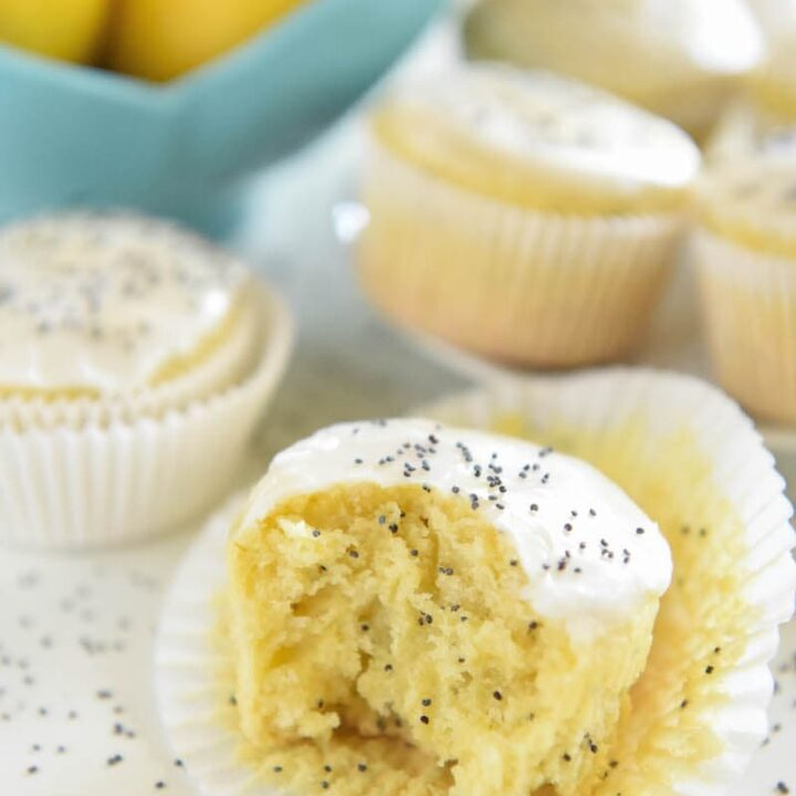 Lemon Yogurt Poppyseed Muffins - one bowl and just 30 minutes to make these deliciously moist muffins! #Lemon #Muffins #breakfast
