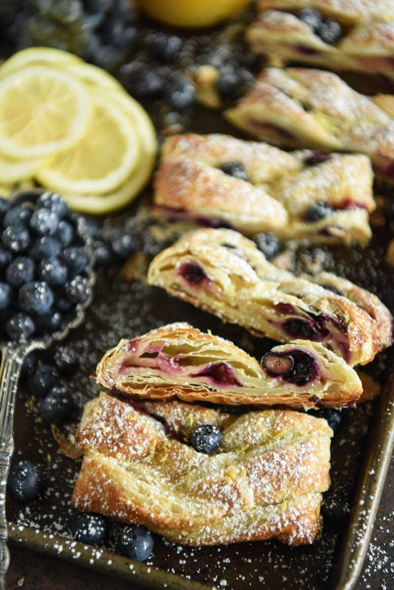 This flaky Blueberry Lemon Braid is filled with cream cheese, lemon curd and blueberries to create an amazing dessert. It is also perfect with coffee for breakfast.