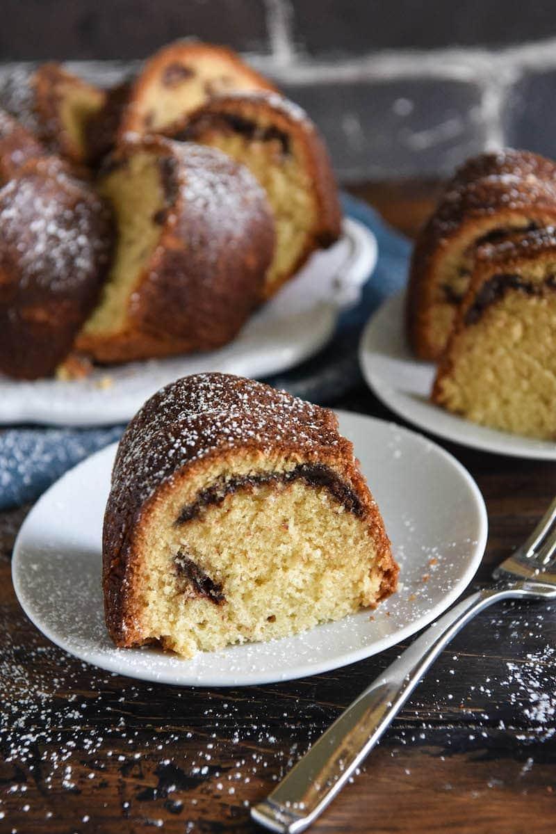 Nutella Swirl Pound Cake: classic buttery vanilla pound cake is swirled with rich nutella! #Nutella #Cake #PoundCake