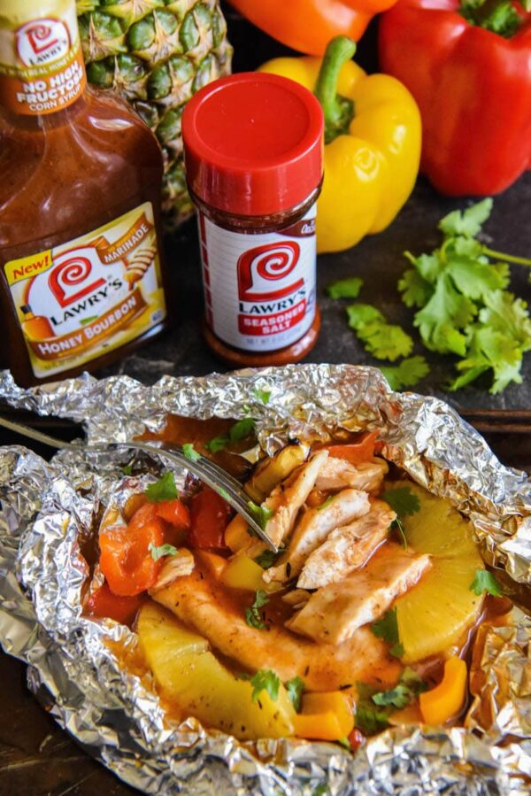 Honey Bourbon Pineapple Chicken Foil Packets: our favorite easy dinner made with your oven, grill or even a campfire! #grill #chicken