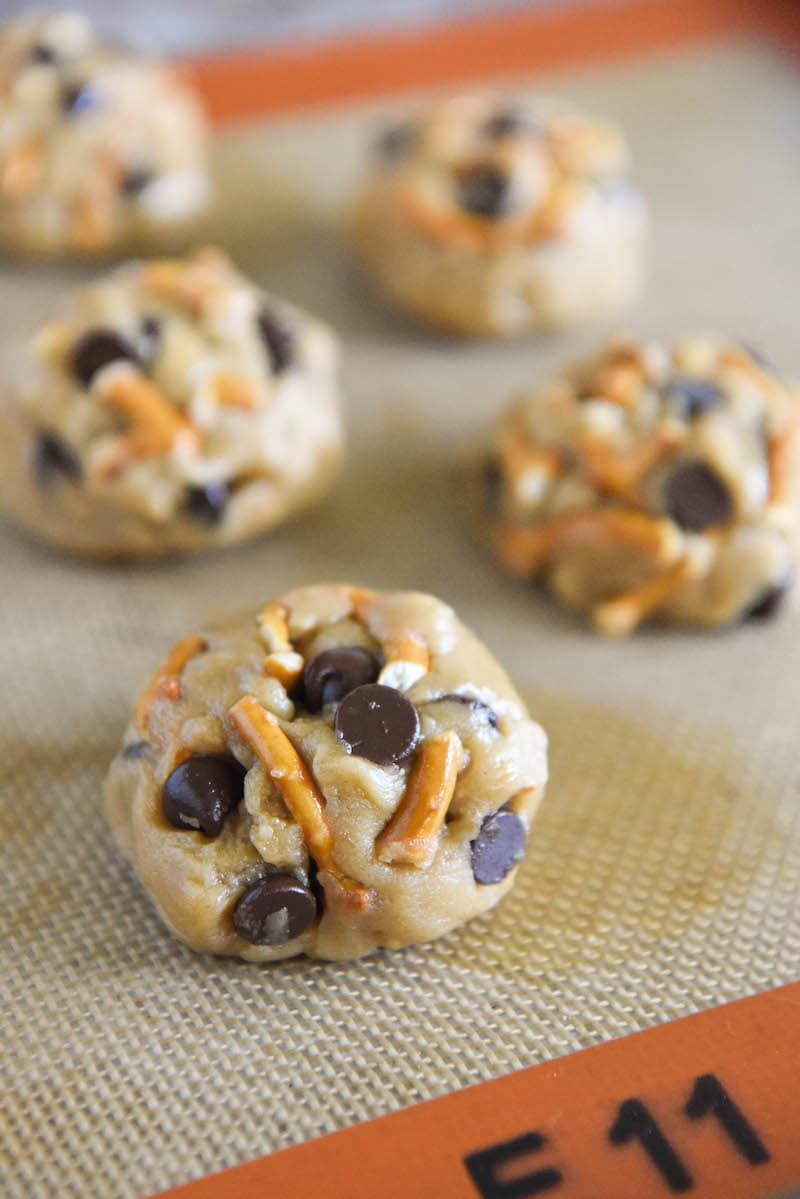 Balls of Sweet and Salty Chocolate Chip Cookie Dough on a Silpat Liner
