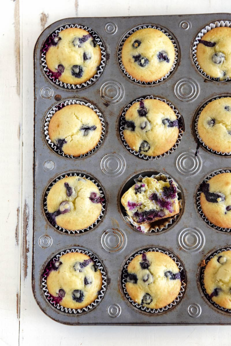 A Muffin Pan FIlled with Freshly Baked Blueberry Muffins