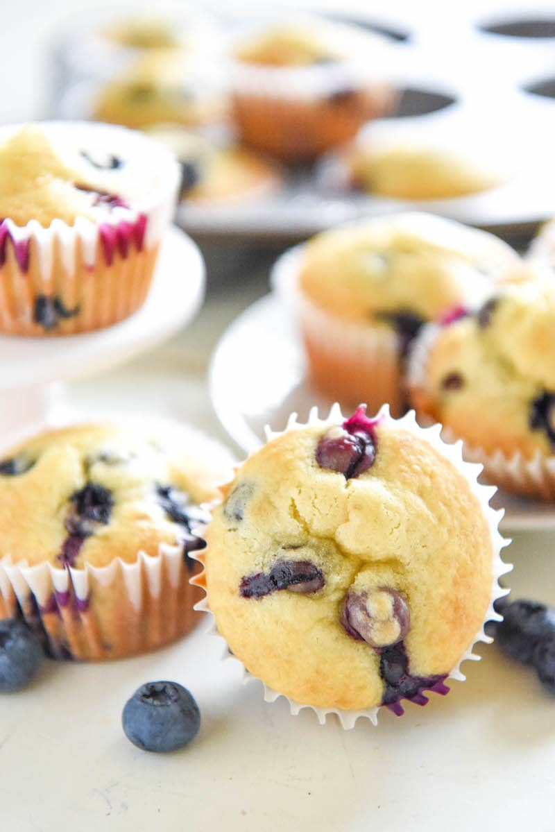 Disney's Blueberry Muffins with Muffin Liners on a White Countertop