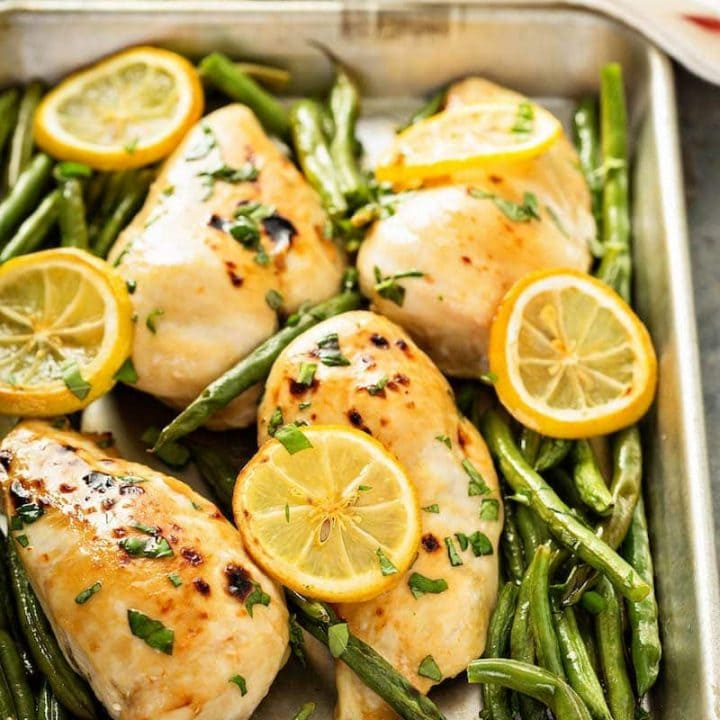 Sheet Pan Roasted Lemon Herb Chicken & Green Beans: our favorite weeknight dinner can be prepped ahead for a super easy one-pan dinner or made fresh in minutes! #dinner #sheetpan #chicken #onepandinner
