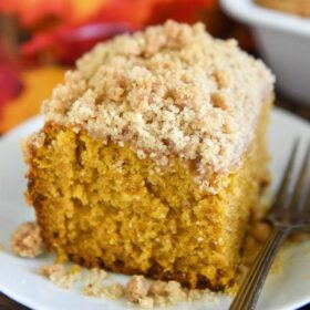 Pumpkin Sour Cream Coffee Cake: an extra moist pumpkin spice cake, topped with a cinnamon crumb topping, makes a perfect Fall breakfast coffee cake or dessert! #Pumpkin #CoffeeCake #Dessert #Cake