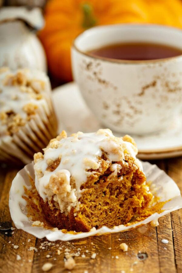 Pumpkin Streusel Muffins: these made from scratch, moist pumpkin spice muffins, are topped with a golden cinnamon streusel and drizzled with cream cheese icing! #pumpkin #muffins #fallrecipes