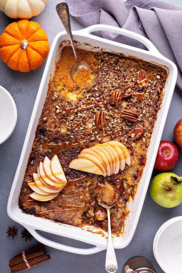 Pumpkin Pecan Cobbler and Caramel Apple Cobbler baked in one casserole dish together.