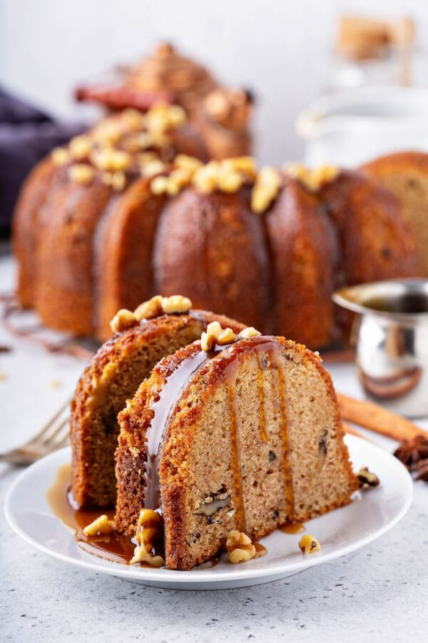 A slice of Walnut Rum Cake drizzled with warm rum sauce.