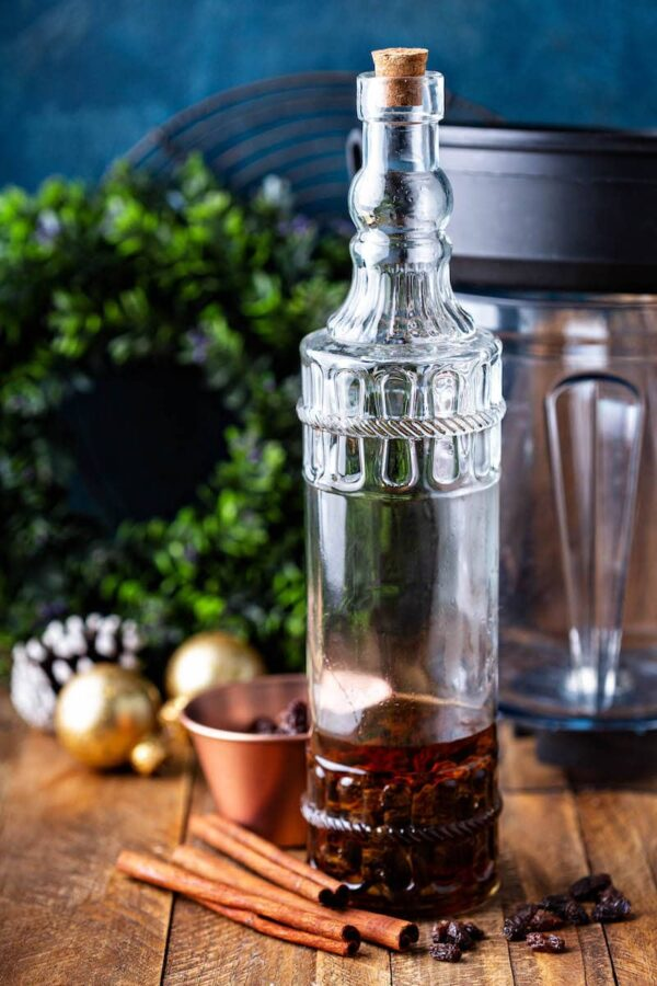 Large bottle with rum raisins and cinnamon.