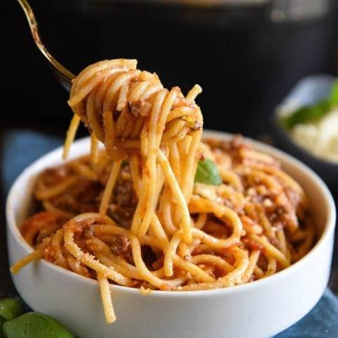 A big forkful of spaghetti bolognese.