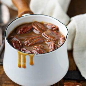 Pecan praline sauce in a sauce pan.