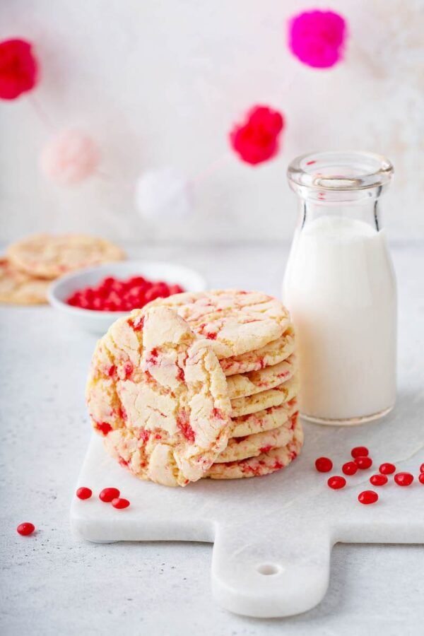 Red hot sugar cookies with a glass of milk.